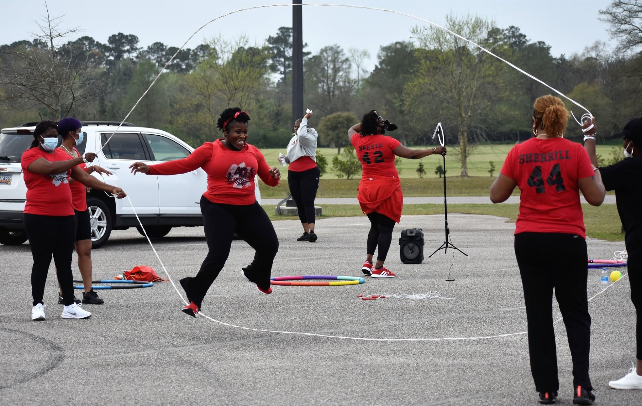 A woman in a red shirt jumps double dutch at the Carrol Campbell Marine Complex